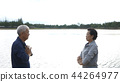 Asian Elderly couple Practice Qi Gong exercise  44264977
