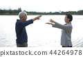 Asian Elderly couple Practice Tai Chi exercise  44264978