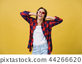 Happy stylish modern woman with modern shaped sunglasses laughing looking at you camera isolated on 44266620