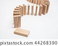 Domino effect - row of white dominoes  44268390