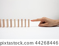 Hand and falling pieces on white background 44268446