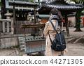 back view of Japanese woman praying 44271305