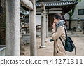 female tourist closing eyes and peaceful blessing 44271311