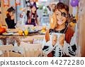 Dark-haired schoolgirl wearing pirate costume for Halloween feeling excited 44272280