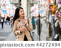 office lady standing outside the show window 44272494