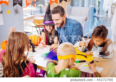 Four children and handsome father preparing decorations for Halloween 44272766