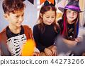 Children feeling entertained while wearing Halloween costumes in kindergarten 44273266