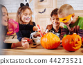 Cute appealing little girl wearing cat costume laughing playing with friends 44273521