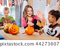 Three children feeling funny while holding scary Halloween toys for the party 44273607
