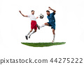 Football players tackling for the ball over white background 44275222