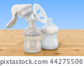 Manual breast pump on the wooden table 44275506