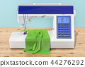 Modern electronic sewing machine with fabric 44276292