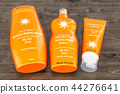 Sunscreen products on the wooden table 44276641
