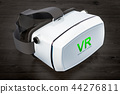 White virtual reality glasses on the wooden table 44276811