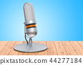 Retro microphone on the wooden table, 3D rendering 44277184