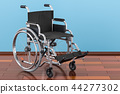 Wheelchair on the wooden floor in the room 44277302