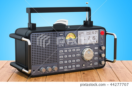 Digital radio on the wooden table, 3D rendering