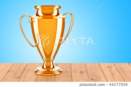 Gold trophy cup award on the wooden table 44277856