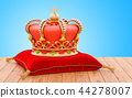 Golden Royal Crown on the red velvet pillow 44278007