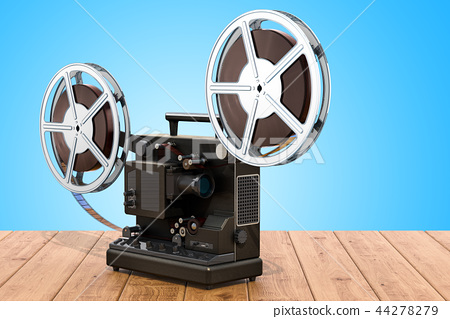 Retro cinema projector on the wooden table 44278279