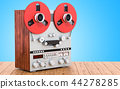 Retro reel-to-reel tape recorder on table 44278285