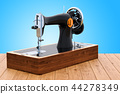 Retro sewing machine on the wooden desk 44278349
