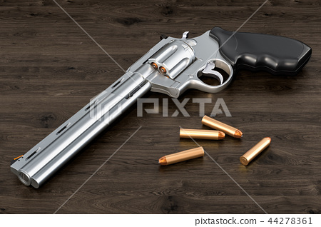 Revolver with bullets on the wooden table 44278361
