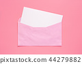 Pink envelope with blank white greeting paper card 44279882