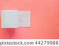 Tissue or toilet paper roll on pink background 44279988