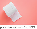 Tissue or toilet paper roll on pink background 44279990