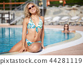 girl at swimming pool 44281119