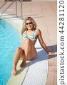 girl at swimming pool 44281120
