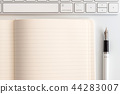 white table notepad, keyboard and fountain pen 44283007