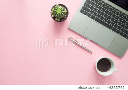 workspace with coffee cup, laptop, pen and plant. 44283761