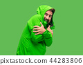 handsome bearded young man isolated on green 44283806