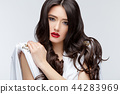 Brunette asian girl with long curly hair 44283969