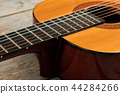 Close up acoustic guitar instrument. 44284266