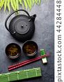 Green tea and sushi chopsticks. Japanese meal set 44284448