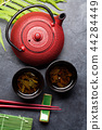 Green tea and sushi chopsticks. Japanese meal set 44284449