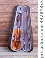 Violin in case on wooden background. 44284855