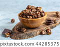 Caramel chocolate popcorn in a wooden bowl. 44285375