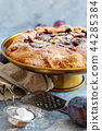 Homemade pie with plums,cinnamon and almond flakes 44285384