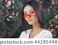 Asian woman fashion close-up portrait outdoors 44285498