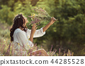 Natural beauty girl with bouquet of flowers outdoor in freedom enjoyment concept. 44285528