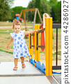Pretty little girl plays outdoor on a summer day. 44286927
