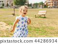 Pretty little girl plays outdoor on a summer day. 44286934