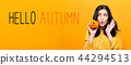 Hello autumn with woman holding a pumpkin 44294513
