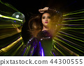 Portrait of beautiful woman holds disco ball 44300555