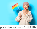 girl in white sweater with LGBT flag 44304487