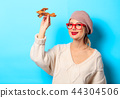 girl iwith wooden toy plane  44304506